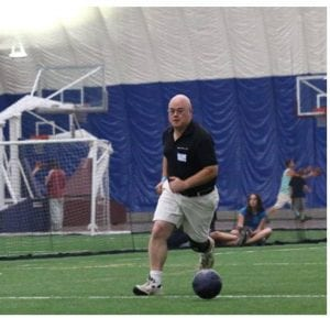 Steve Gustafson playing soccer