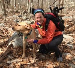 Kim Bradley and a canine companion on the trail