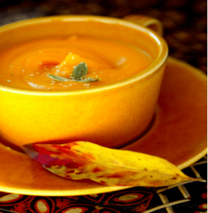 bowl of pumpkin soup on a saucer