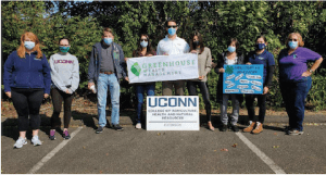 group of people wearing masks and holding signs
