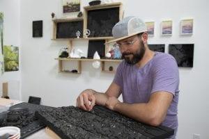Joseph Smolinski works on a sea coal mosaic in his New Haven studio. Photo: Jessica Smolinski